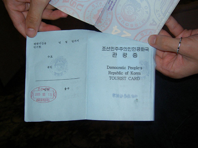 A U.S. passport with a DPRK tourist card inside.