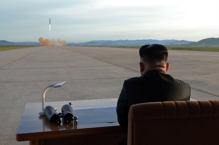 Kim Jong Un watches the launch of a Hwasong-12 IRBM