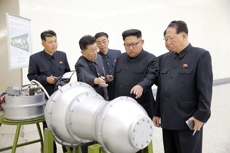 North Korean leader Kim Jong Un inspects what Pyongyang claims to be a miniaturized thermonuclear warhead